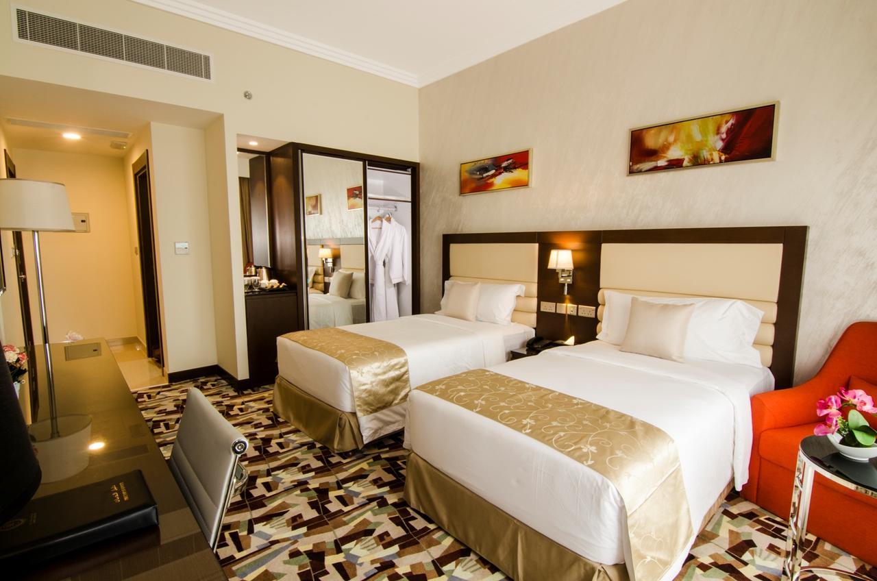 غرفة نوم في الفندق