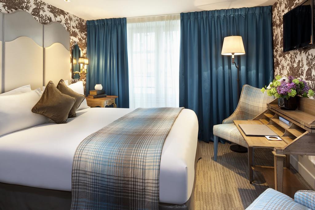 غرفة نوم في فندق لا ميزون فافار