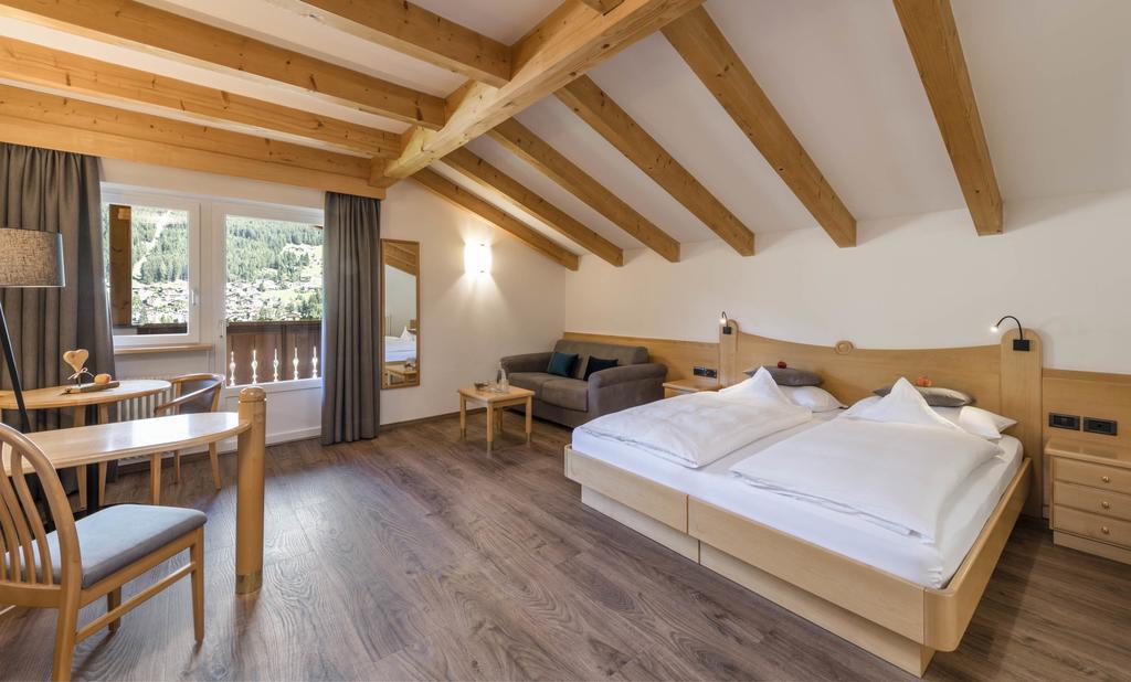 صورة لاحد الغرف في فندق ألبين هوتيل راينيل ايطاليا