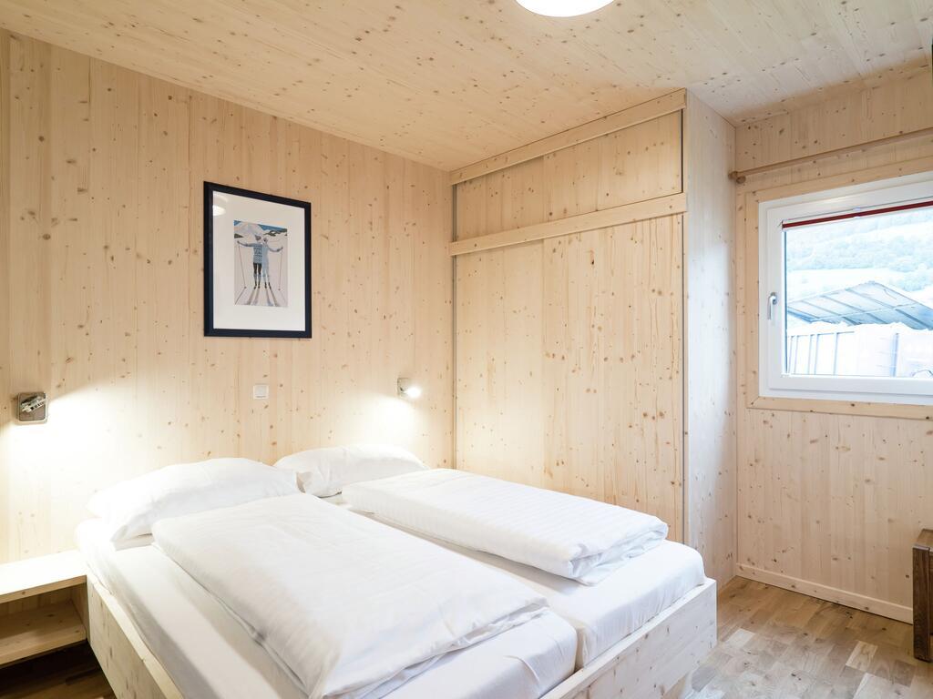 صورة لاحد الغرف الجميلة في شاليه بانوراما 21 النمسا